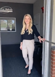 Layce Howell, OT welcomes virtual visitors to the Total Rehab-Eufaula clinic during a Facebook Live tour.
